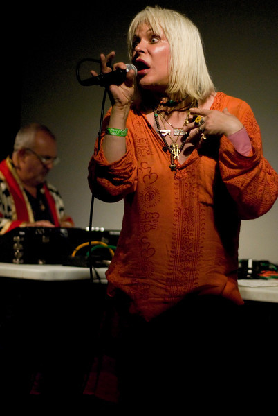 Genesis P-Orridge, Peter Christopherson in the background.