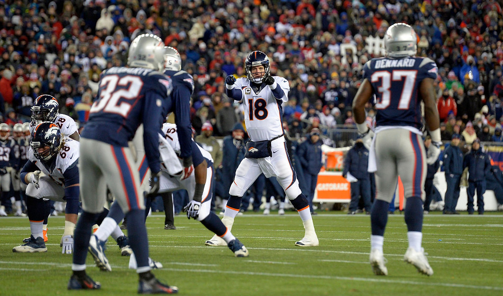 . Denver Broncos quarterback Peyton Manning (18) points out the New England Patriots defense during the first quarter  November 24, 2013 at Gillette Stadium. (Photo by John Leyba/The Denver Post)