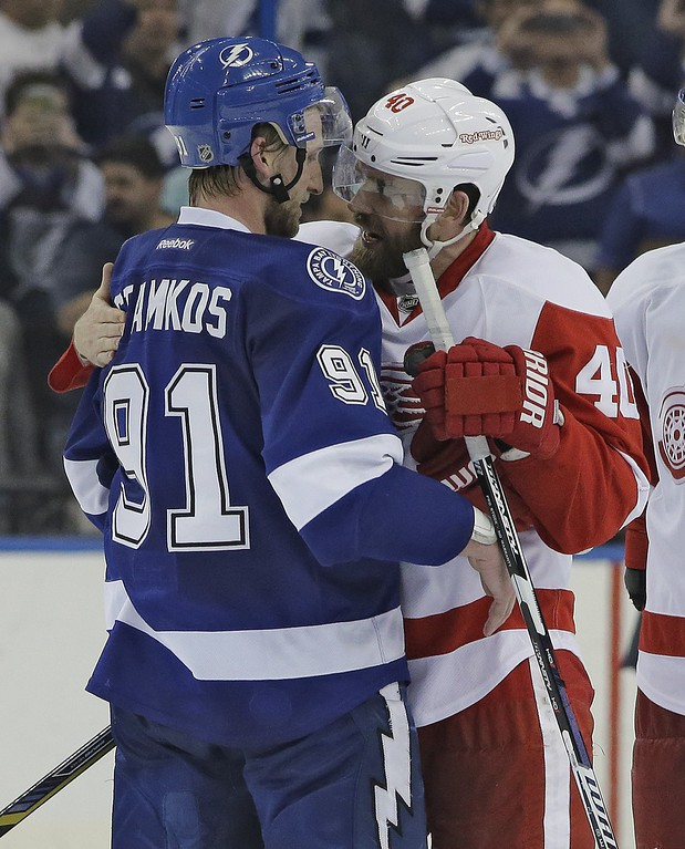. Detroit Red Wings left wing Henrik Zetterberg (40), of Sweden, congratulates Tampa Bay Lightning center Steven Stamkos (91) after the Lightning defeated the Red Wings 2-0 during Game 7 of a first-round NHL Stanley Cup hockey playoff series Wednesday, April 29, 2015, in Tampa, Fla. (AP Photo/Chris O\'Meara)