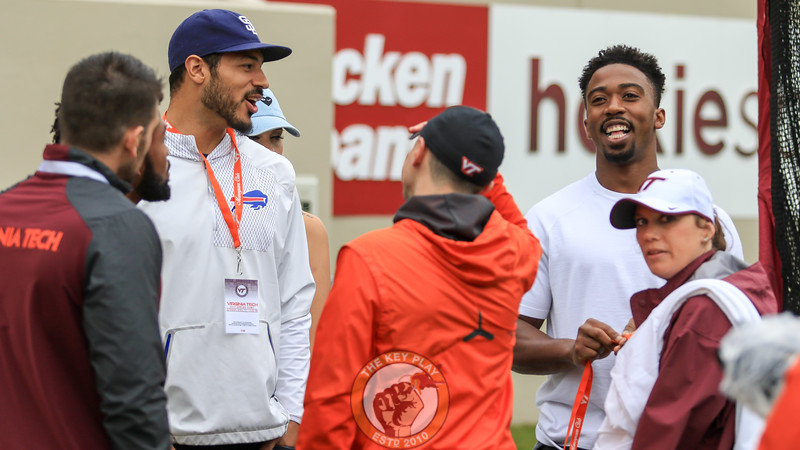 Former Virginia Tech quarterbacks and current Buffalo Bills teammates Logan Thomas (left) and Tyrod Taylor (right) share a laugh on the sidelines during the spring game. (Mark Umansky/TheKeyPlay.com)