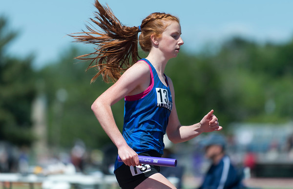 06/03/19 Wesley Bunnell   Staff The CIAC held their open track and field state open at Willow Brook Park on Monday afternoon. Southington girls competing during the 4x800 meter relay.