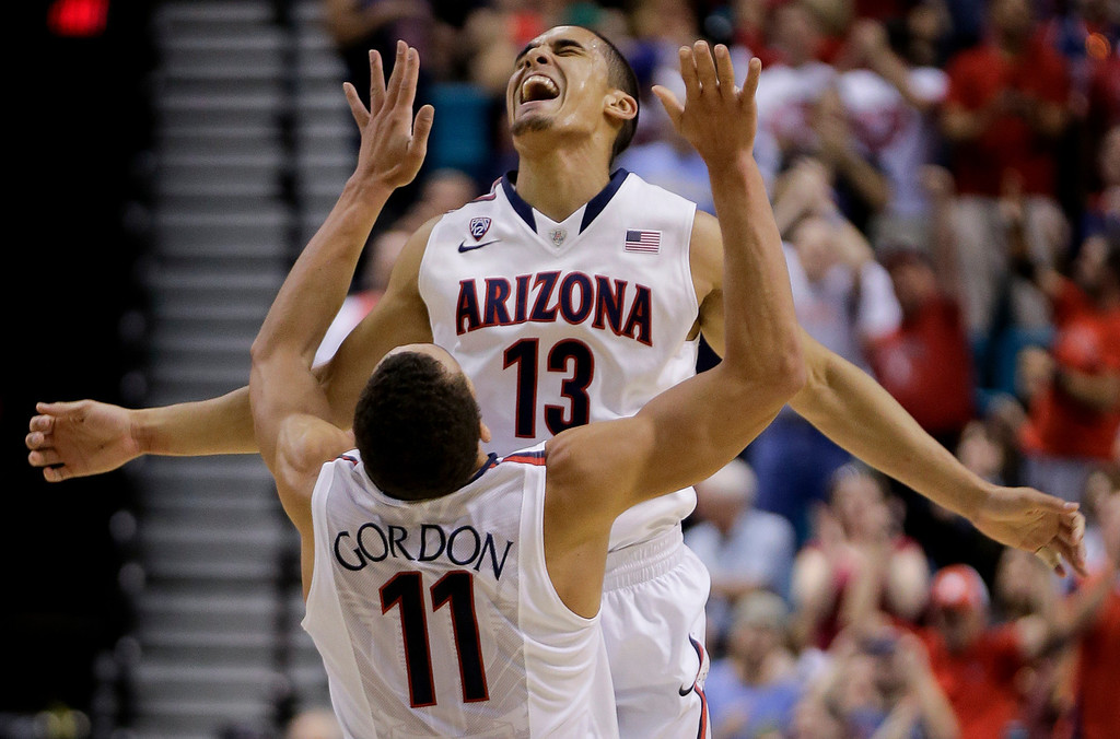 . Arizona\'s Nick Johnson (13) reacts with Aaron Gordon after hitting a 3-point basket against Colorado during the first half of an NCAA college basketball game in the semifinals of the Pac-12 Conference on Friday, March 14, 2014, in Las Vegas. (AP Photo/Julie Jacobson)