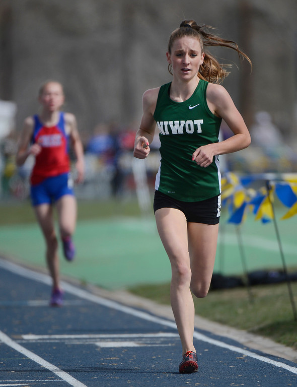 . DENVER, CO. - APRIL 13TH: Elise Cranny, Niwot High School, right, rounds turn one during the girls 1600 meter run at the Mullen Runners Roost 2013 Track and Field Invitational at Mullen High School, Saturday April, 13th 2013.(Photo By Andy Cross/The Denver Post)