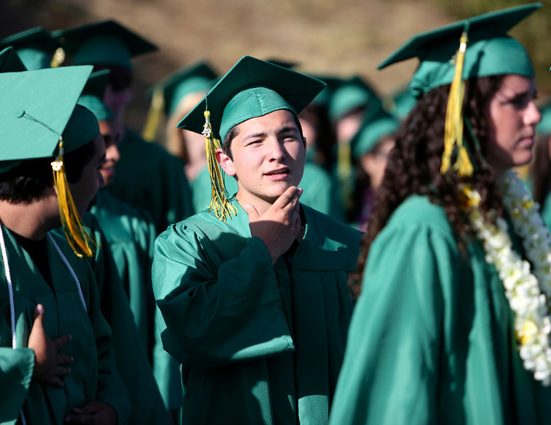 . Harbor High seniors look to their futures as they march to the Cabrillo College football field in Aptos on Friday. (Kevin Johnson/Sentinel)