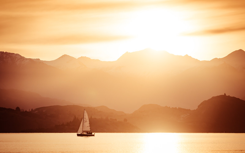 sailboat-golden-sunset-lake-wanaka-new-zealand.jpg