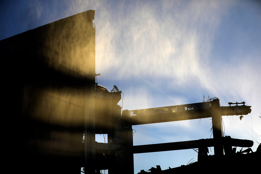 . A wall of the Georgia Dome remains standing after the stadium was imploded in Atlanta, Monday, Nov. 20, 2017. The dome was not only the former home of the Atlanta Falcons but also the site of two Super Bowls, 1996 Olympics Games events and NCAA basketball tournaments among other major events. (AP Photo/David Goldman)