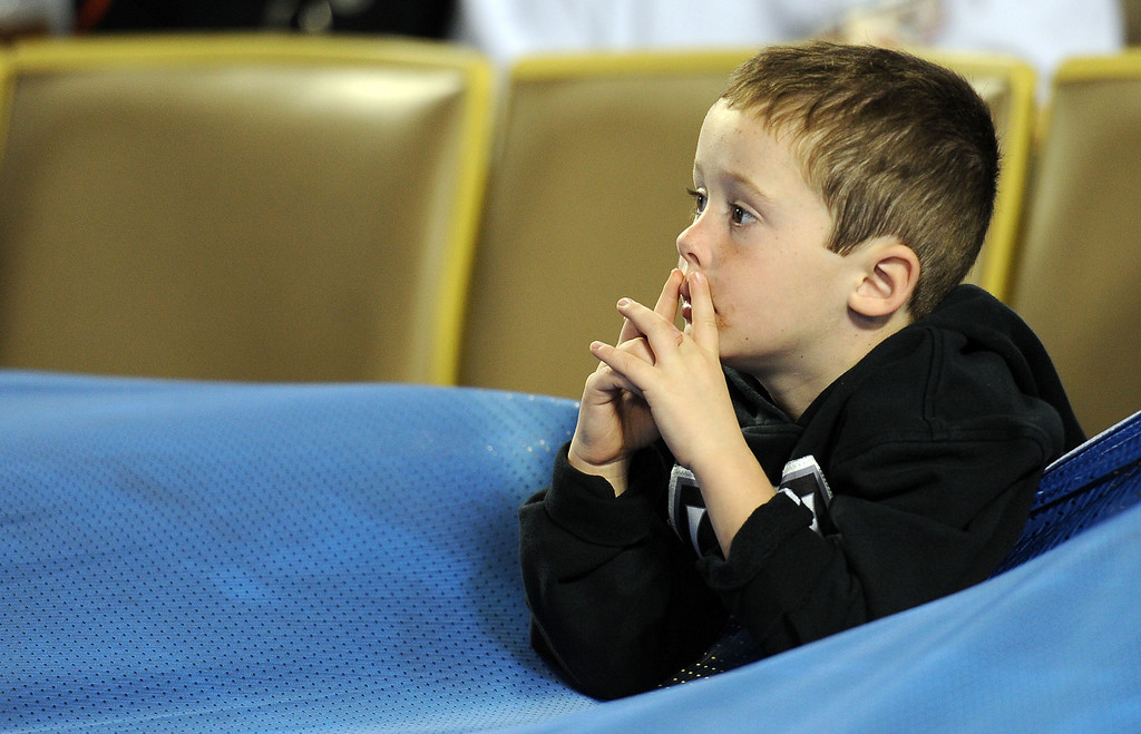 . A young Los Angeles Kings fans looks toward the ice prior to the start of the inaugural NHL Stadium Series game against the Anaheim Ducks at Dodger Stadium in Los Angeles on Saturday, Jan. 25, 2014. (Keith Birmingham Pasadena Star-News)
