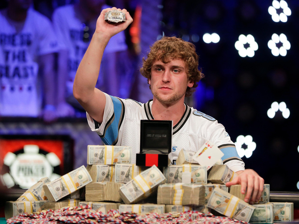 . Ryan Riess holds up the championship bracelet after defeating Jay Farber for the $8.4 million payout in the World Series of Poker Final Table, Tuesday, Nov. 5, 2013, in Las Vegas. (AP Photo/Julie Jacobson)