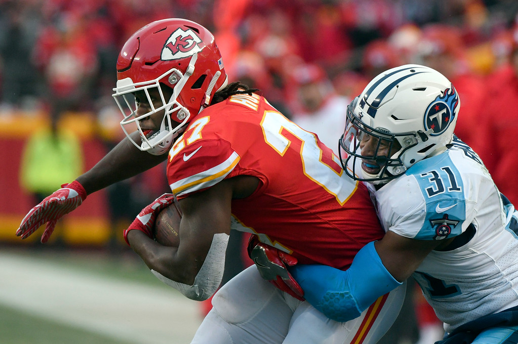 . Tennessee Titans safety Kevin Byard (31) tackles Kansas City Chiefs running back Kareem Hunt (27) during the first half of an NFL wild-card playoff football game in Kansas City, Mo., Saturday, Jan. 6, 2018. (AP Photo/Ed Zurga)