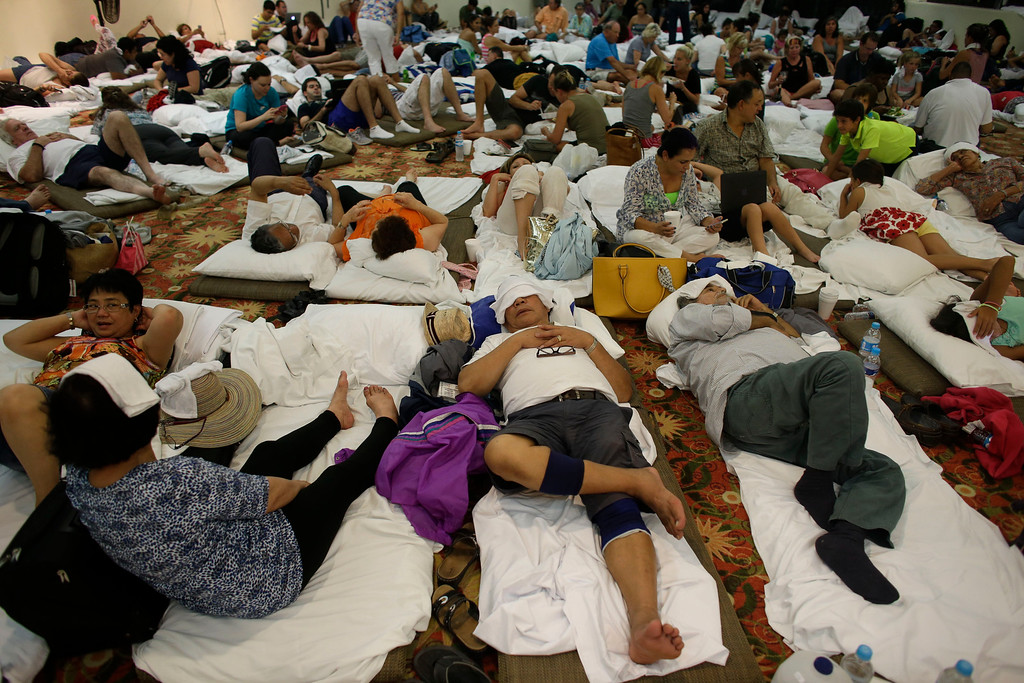. Tourists rest inside a shelter at a resort in Los Cabos, Mexico,  Sunday, Sept. 14, 2014. Hurricane Odile is expected to make a close brush with the southern portion of Mexico\'s Baja California peninsula Sunday evening. (AP Photo/Victor R. Caivano)