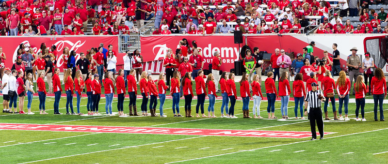 The UH Women's Swimming and Diving team is honored during a time-out.