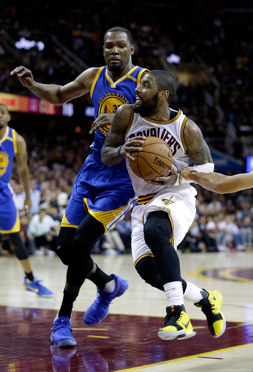 . Cleveland Cavaliers guard Kyrie Irving (2) drives on Golden State Warriors forward Kevin Durant (35) during the second half of Game 3 of basketball\'s NBA Finals in Cleveland, Wednesday, June 7, 2017. Golden State won 118-113. (AP Photo/Tony Dejak)
