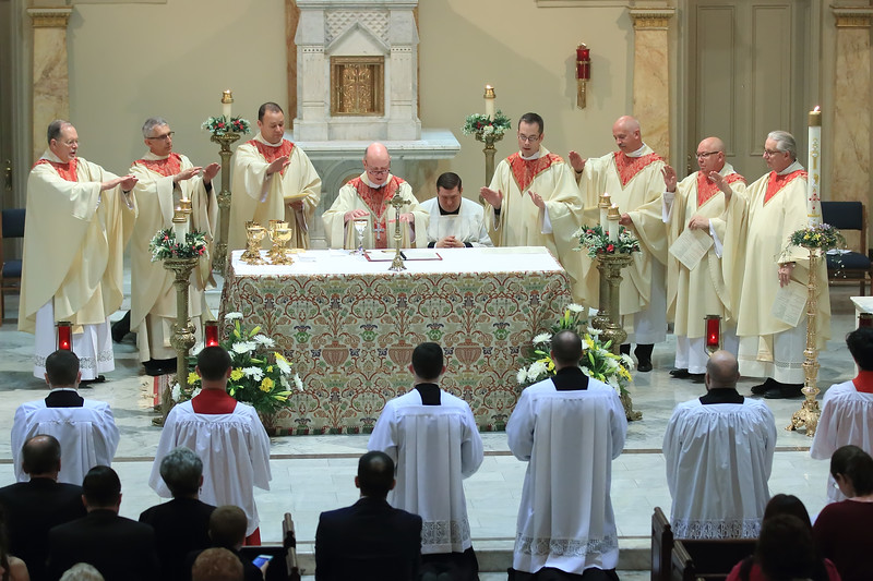 Bishop Malooly blesses the host with Richard Jasper and other Priests during his Ordination at Cathedral of Saint Peter Church, Saturday, May 20, 2017. wwwDonBlakePhotography.com