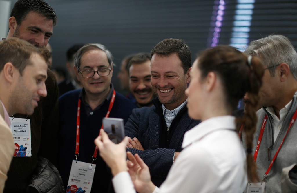 . Visitors look the new Samsung Galaxy S9+ mobile phone during the Mobile World Congress wireless show, in Barcelona, Spain, Tuesday, Feb. 27, 2018. The annual Mobile World Congress (MWC) runs from 26 February - 1 March and draws over 2,300 exhibitors to Barcelona, including industry heavyweights Samsung, Huawei and Nokia. (AP Photo/Manu Fernandez)
