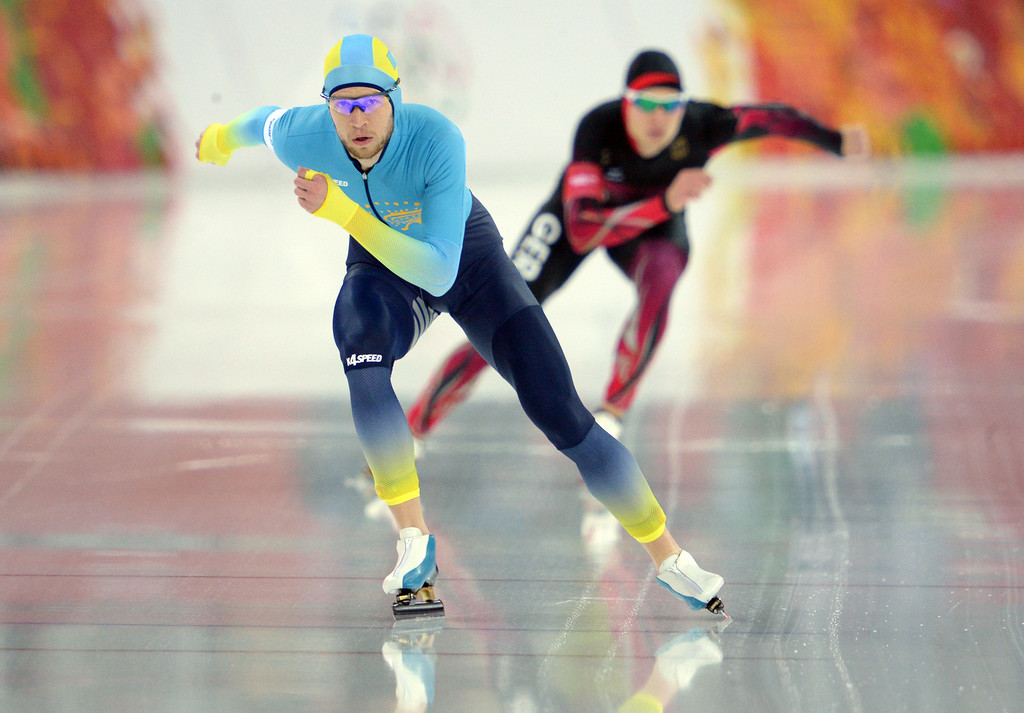 . Kazakhstan\'s Dmitriy Babenko (L) and Germany\'s Patrick Beckert competes in the Men\'s Speed Skating 10000 m at the Adler Arena during the Sochi Winter Olympics on February 18, 2014. YURI KADOBNOV/AFP/Getty Images