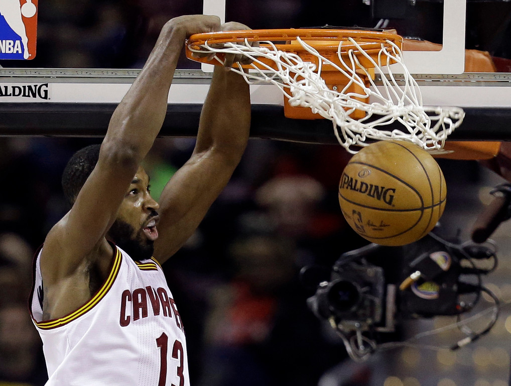 . Cleveland Cavaliers\' Tristan Thompson dunks against the Brooklyn Nets in the first half of an NBA basketball game, Friday, Jan. 27, 2017, in Cleveland. (AP Photo/Tony Dejak)