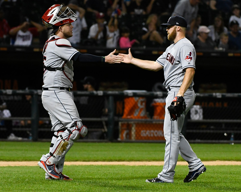 . Cleveland Indians catcher Roberto Perez, left, and relief pitcher Cody Allen high-five after a baseball game against the Chicago White Sox, Saturday, Aug. 11, 2018, in Chicago. (AP Photo/Matt Marton)