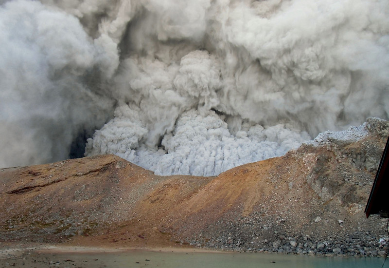. In this photo taken by an anonymous climber and was offered to Kyodo News, dense plumes rise near the summit crater of Mt. Ontake as the volcanic mountain erupts in central Japan, Saturday, Sept. 27, 2014. With a sound likened to thunder, the 3,067-meter (10,062-foot) mountain spewed large white plumes high into the sky, sending people fleeing, covering surrounding areas in ash, with more than 250 people stuck on the slopes for hours, many taking refuge in mountain lodges that dot the way up. (AP Photo/Kyodo News)