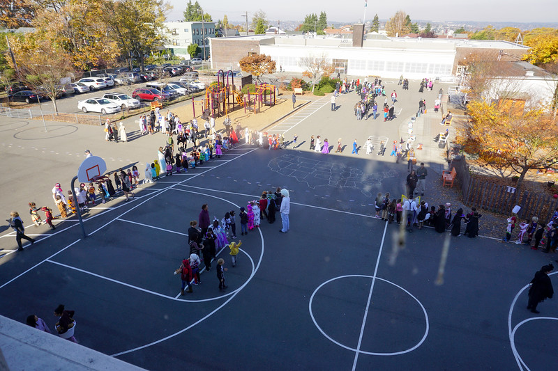 Classes organizing on the playground for the annual Halloween parade