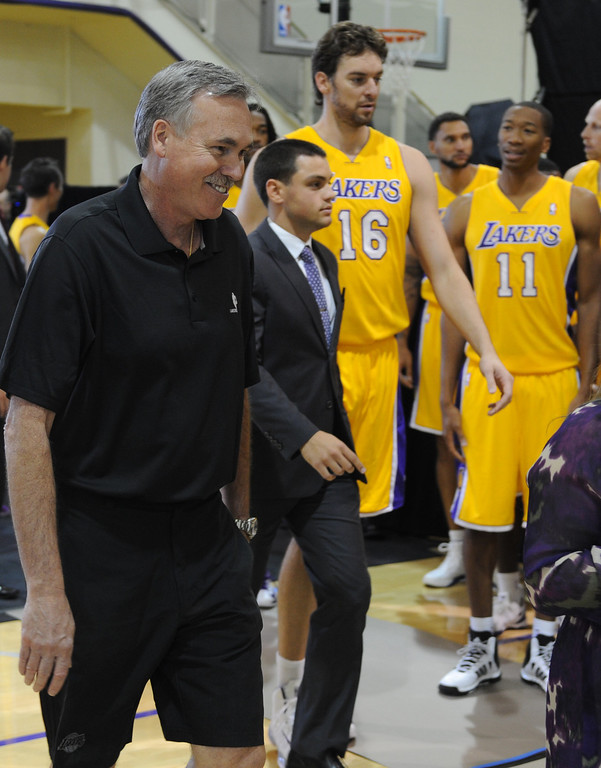 . Laker coach Mike D\'Antoni enters for media day. The Los Angeles Lakers held a media day at their El Segundo practice facility. Players were photographed for team materials, and interviewed by the press. El Segundo, CA. 9/27/2013. photo by (John McCoy/Los An8eles Daily News)