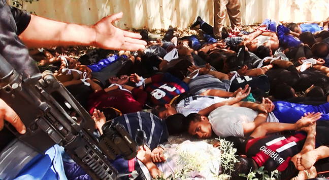 . This image posted on a militant website on Saturday, June 14, 2014, which has been verified and is consistent with other AP reporting, appears to show militants from the al-Qaida-inspired Islamic State of Iraq and the Levant (ISIL) with captured Iraqi soldiers wearing plain clothes after taking over a base in Tikrit, Iraq. The Islamic militant group that seized much of northern Iraq has posted photos that appear to show its fighters shooting dead dozens of captured Iraqi soldiers in a province north of the capital Baghdad. Iraq\'s top military spokesman Lt. Gen. Qassim al-Moussawi confirmed the photos� authenticity on Sunday and said he was aware of cases of mass murder of Iraqi soldiers. (AP Photo via militant website)