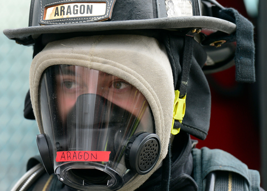 . Matt Aragon, 17, is dressed in full gear, ready to enter a training building filled with fire and smoke. Douglas County School District students enrolled in the Fire Science program join firefighters in search and rescue and extinguishment scenarios at the South Metro Fire Rescue Training Center in Parker. The students have been training all year with the firefighters who have all volunteered their time to help train the students through this program. (Photo by Kathryn Scott Osler/The Denver Post)