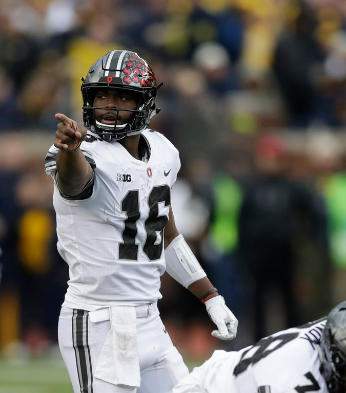 . Ohio State quarterback J.T. Barrett (16) sends signals to his team during the first half of an NCAA college football game against Michigan, Saturday, Nov. 25, 2017, in Ann Arbor, Mich. (AP Photo/Carlos Osorio)