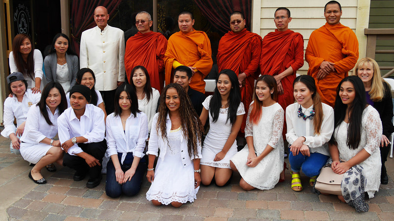 George, Pui, Buddhist Monks, staff, friends and family attend the Grand Opening.