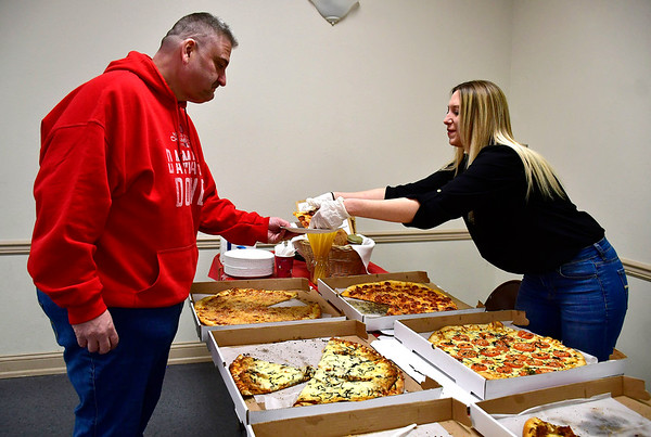 3/14/2019 Mike Orazzi | Staff David LaFleur gets some pizza from First and Last Tavern's Christina Pascale during the Plainville Chamber of Commerce 2019 Pizza Feud at the Veterans of Foreign Wars in Plainville Thursday evening.