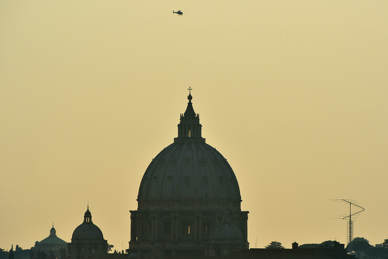 . A helicopter passes by the dome of St Peter\'s basilica at the Vatican on February 28, 2013 in Rome.  Benedict will board a helicopter at around 1600 GMT to fly to the papal summer residence of Castel Gandolfo outside Rome, where he will stay until his powers formally expire at 1900 GMT.  GABRIEL BOUYS/AFP/Getty Images