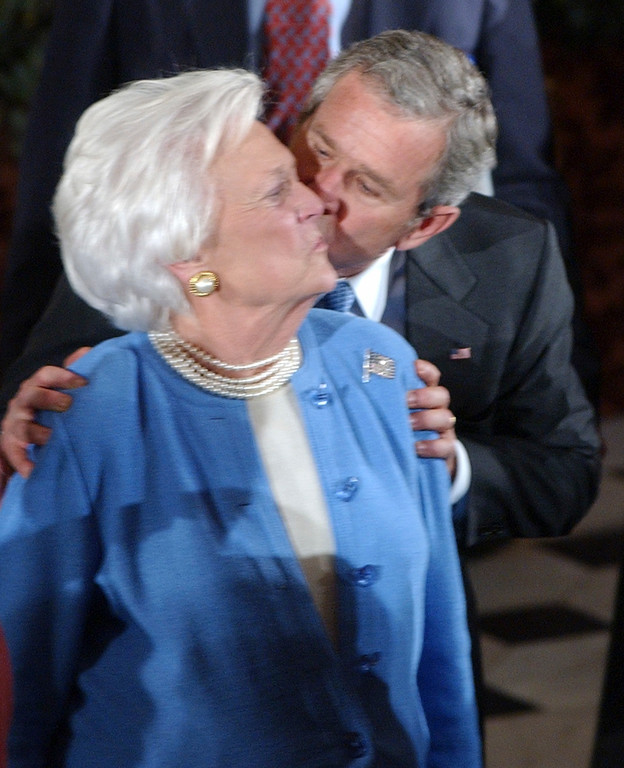 . President Bush kisses his mother, Barbara Bush, at the Capitol in Washington Thursday, Jan. 20, 2005, after being sworn in for a second term. (AP Photo/Dennis Cook)