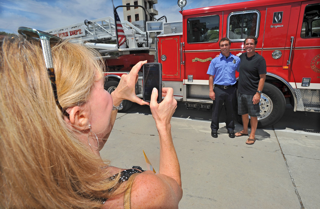 . LONG BEACH - 08/02/2013  (Photo: Scott Varley, Los Angeles News Group)  25 new ambulance drivers graduated from the Long Beach Fire Department\'s two week training academy and received their LBFD badges during a short ceremony. Adam Fedele poses for family photos after graduating.