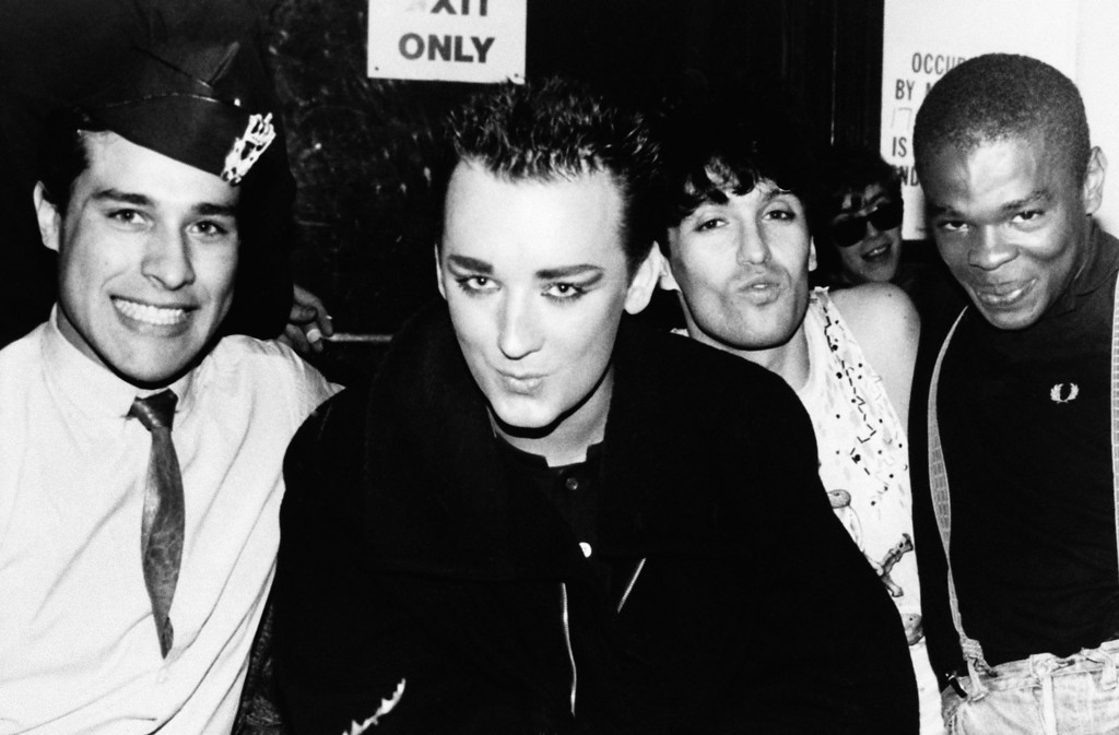 . Rock Star Boy George, center, sporting a short hairdo, poses with some friends at the limelight Wednesday, Jan. 24, 1985 in New York. (AP Photo)