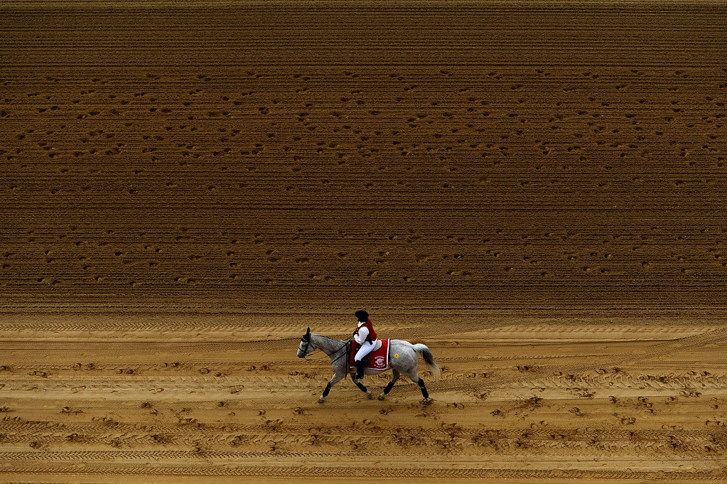 . BALTIMORE, MD - MAY 18:  An outrider goes over the track prior to a race before the start of the 138th running of the Preakness Stakes at Pimlico Race Course on May 18, 2013 in Baltimore, Maryland.  (Photo by Patrick Smith/Getty Images)