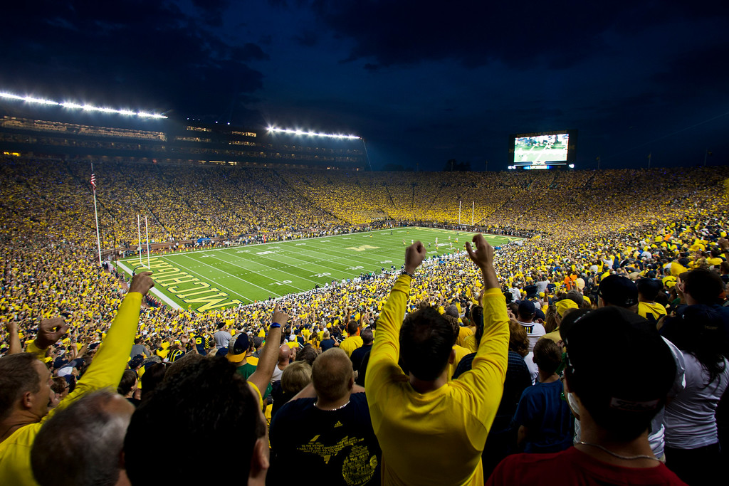 . Fans cheer on Michigan and Notre Dame as they begin an NCAA college football game at Michigan Stadium, in Ann Arbor, Mich., Saturday, Sept. 7, 2013. This is only the second ever night game played at Michigan Stadium. (AP Photo/Tony Ding)