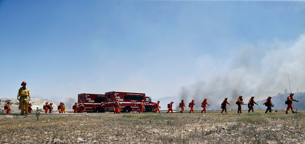 . California firefighters arrive to assist local fire personnel in a battle against a wild fire Tuesday, May 13, 2014, in San Diego.   (AP Photo)