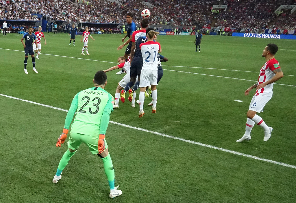 . Croatia\'s Mario Mandzukic, center, scores an own goal past Croatia goalkeeper Danijel Subasic during the final match between France and Croatia at the 2018 soccer World Cup in the Luzhniki Stadium in Moscow, Russia, Sunday, July 15, 2018. (AP Photo/Pavel Kopczynski, Pool via AP)