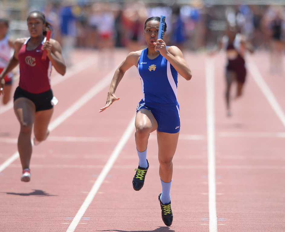 . St. Mary\'s Academy\'s Rachel Toliver anchors her team to a win in the 4x100 meter Division 4 relay race of the CIF Southern Section Track and Field Championships Saturday at Mt. SAC. 20130518 Photo by Steve McCrank / Staff Photographer