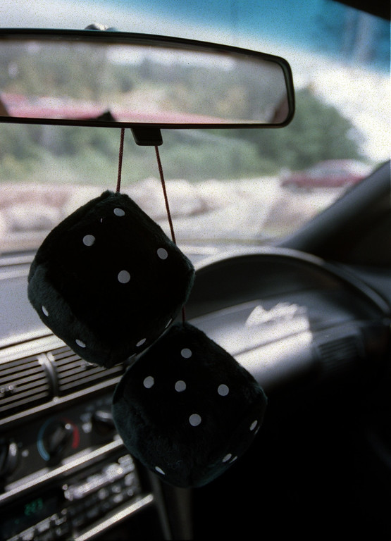 . Fuzzy Dice on rear view mirror for Dream Cruise coverage.