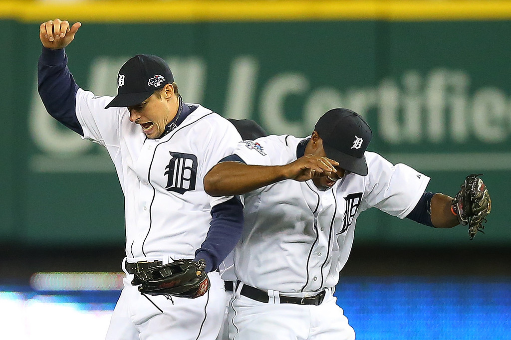 . Don Kelly #32 Austin Jackson #14 and Torii Hunter #48 of the Detroit Tigers celebrate their 7 to 3 win over the Boston Red Sox in Game Four of the American League Championship Series at Comerica Park on October 16, 2013 in Detroit, Michigan.  (Photo by Ronald Martinez/Getty Images)
