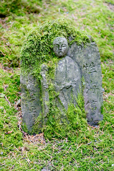 A small moss-covered Buddha stelle