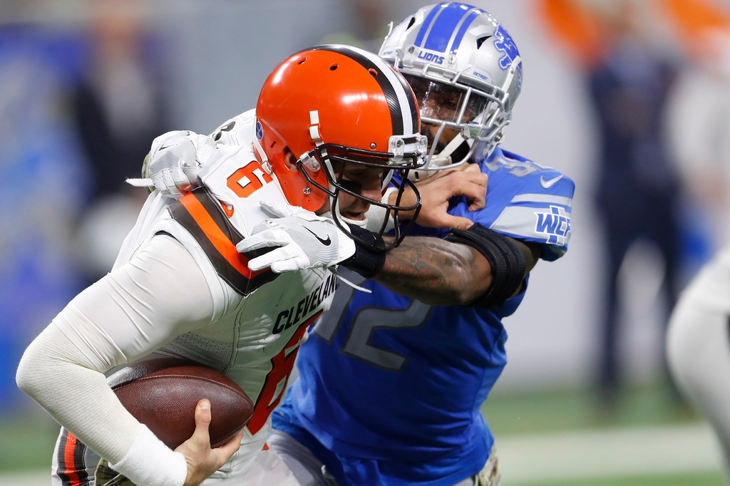 . Cleveland Browns quarterback Cody Kessler (6) is tackled by Detroit Lions strong safety Tavon Wilson (32) during the second half of an NFL football game, Sunday, Nov. 12, 2017, in Detroit. (AP Photo/Paul Sancya)