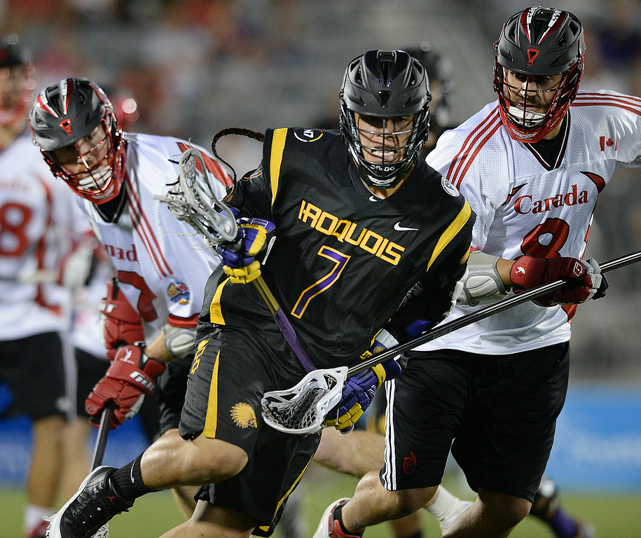 . COMMERCE CITY, CO - JULY 17: Iroquois attack Miles Thompson (7) looked for an opening in the second half. The Iroquois Nationals took on Canada in a FIL World Championship semifinal game Thursday night, July 17, 2014.  Photo by Karl Gehring/The Denver Post