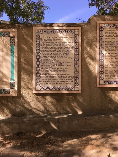 Framed tile panels like this one from 1989 offer the same prayer in two dozen languages