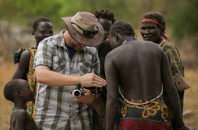 Villagers look over the shoulder of Josh Thulin as he operates his camera Photo by Jason Ransom 2016-03-31