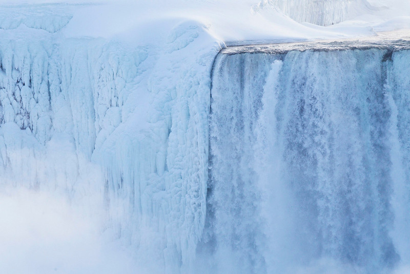 . Masses of ice form around the Canadian \'Horseshoe\' Falls as seen from Niagara Falls, Ontario, Canada, Thursday, Feb. 19, 2015. (AP Photo/The Canadian Press,Aaron Lynett)