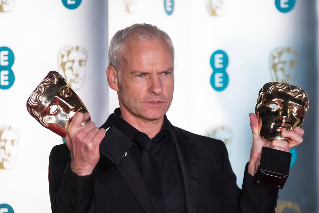 . Director Martin McDonagh poses for photographers with the Best Film and Best British Film awards for \'Three Billboards Outside Ebbing, Missouri\' upon arrival at the BAFTA 2018 afterparty in London, Sunday, Feb. 18, 2018. (Photo by Vianney Le Caer/Invision/AP)