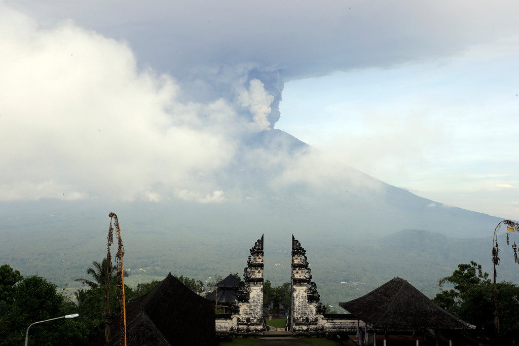 . Clouds of ashes raise from the Mount Agung volcano erupting in Karangasem, Indonesia, Monday, Nov. 27, 2017. Indonesia authorities raised the alert for the rumbling volcano to highest level on Monday and closed the international airport on tourist island of Bali stranding thousands of travelers. (AP Photo/Firdia Lisnawati)