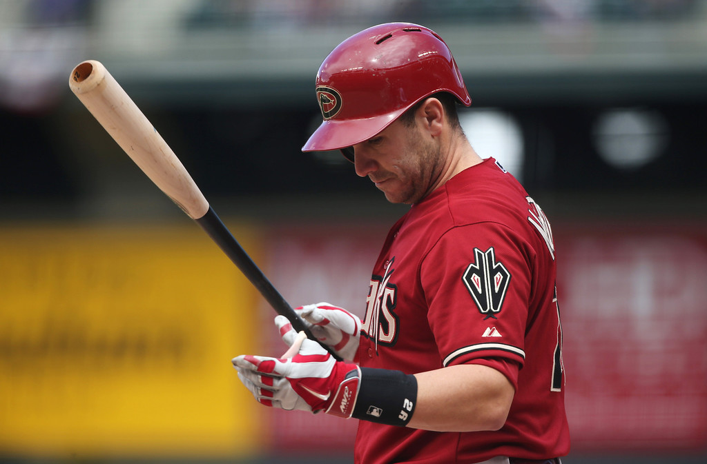 . Arizona Diamondbacks\' Miguel Montero reacts after striking out while swinging with the bases loaded agaisnt the Colorado Rockies to end the top of the first inning of a baseball game in Denver on Sunday, April 6, 2014. (AP Photo/David Zalubowski)