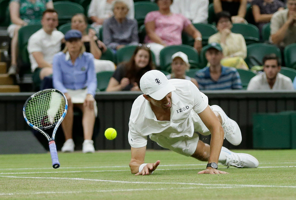 . Mike Bryan of the United States falls trying to return a shot during his and his partner Jack Sock\'s men\'s doubles final match against South Africa\'s Raven Klaasen and New Zealand\'s Michael Venus at the Wimbledon Tennis Championships, in London, Saturday July 14, 2018.(AP Photo/Tim Ireland)